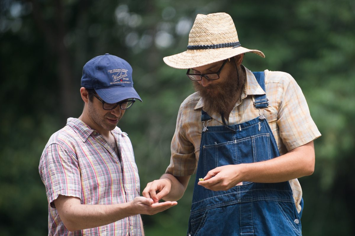 'Farmer Nate' Kleinman shows William Levin (left) seeds at one of the fields of the Alliance Colony 'reboot' in , Pittsgrove, NJ.