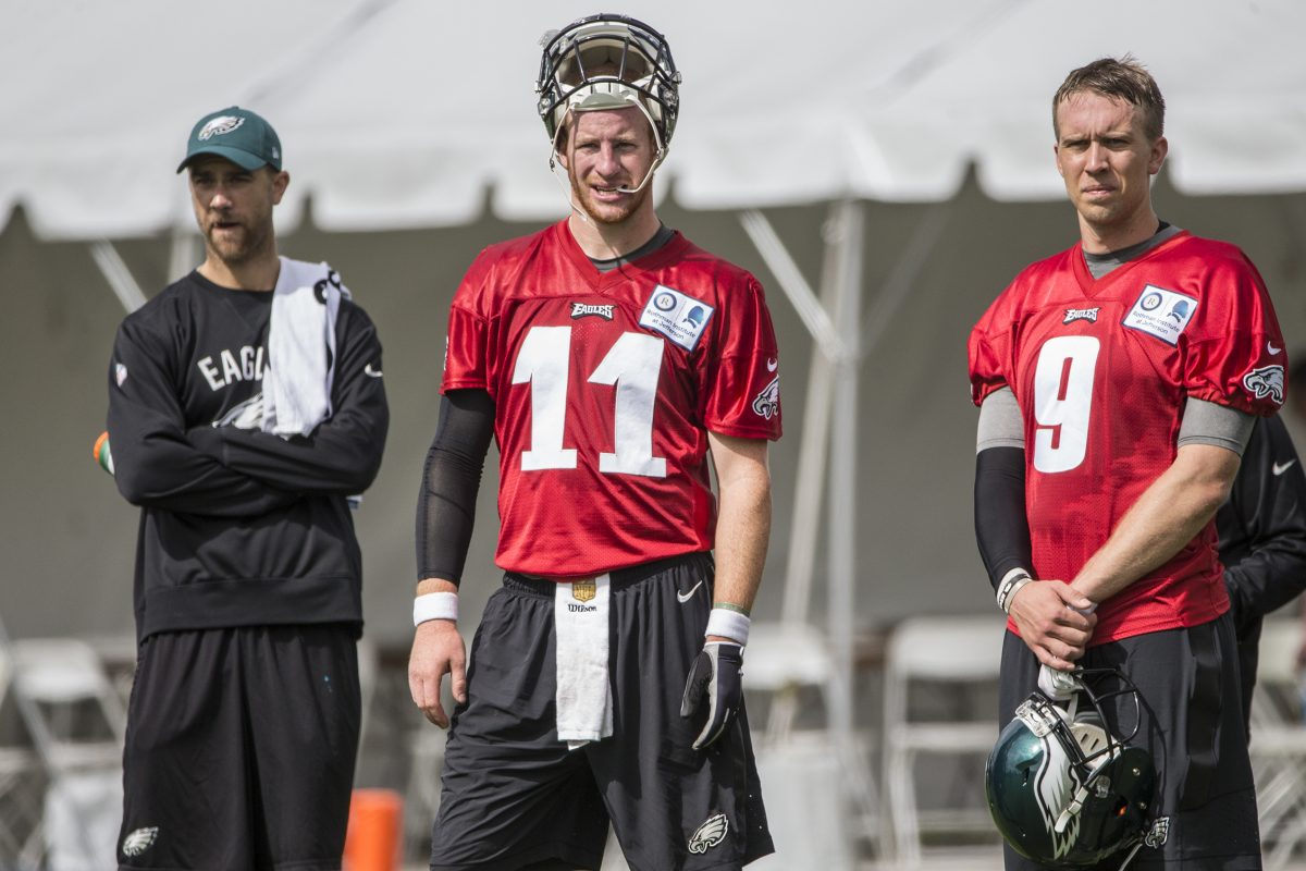 Eagles quarterbacks Carson Wentz, left, and Nick Foles, drill Monday morning, July 24, 2017 the first day of Eagles training camp at the NovaCare Complex.