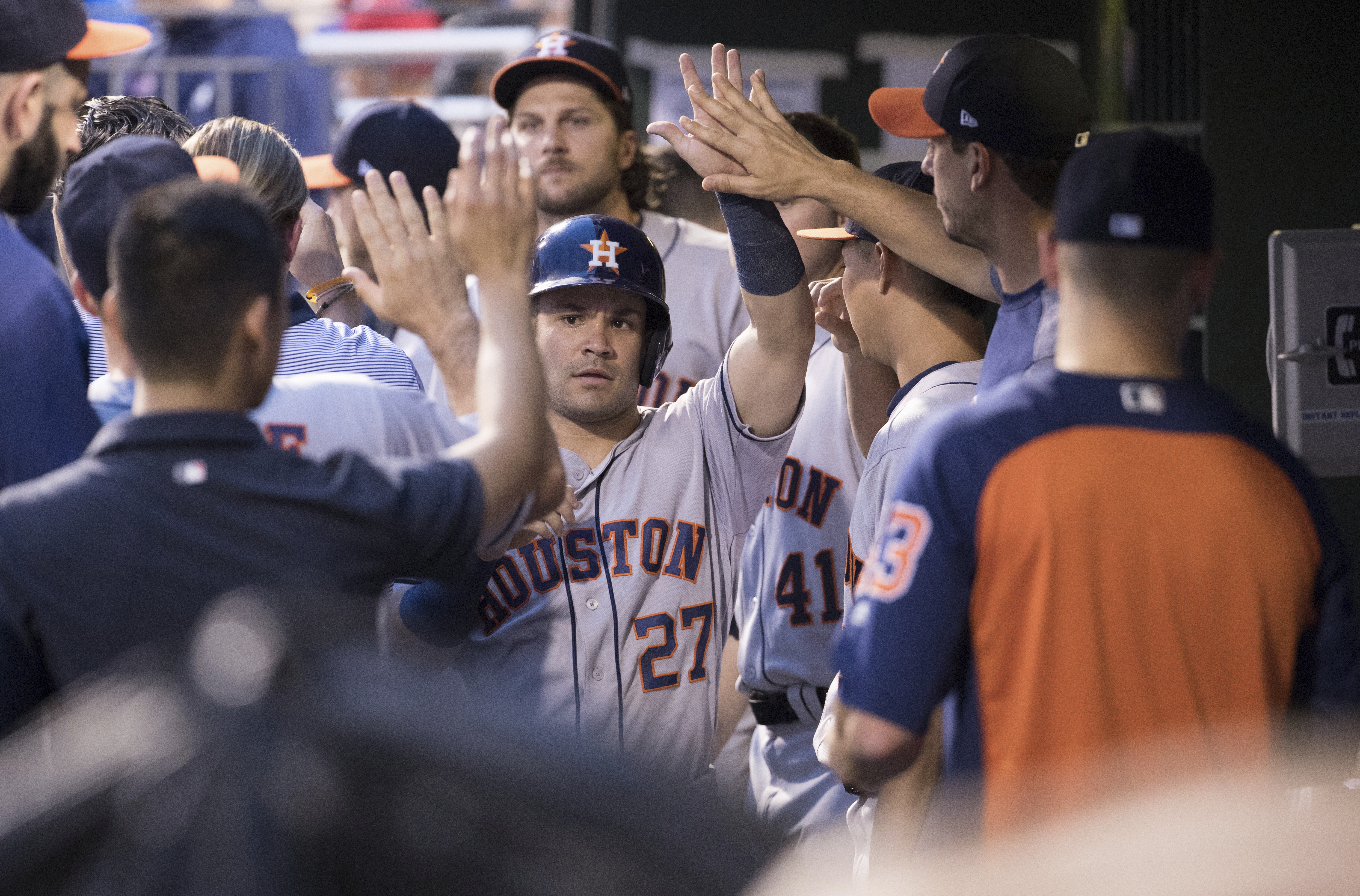 Houston second baseman Jose Altuve gets high fives after scoring one of his three runs Monday. He had four of the Astros´ 18 hits. (AP Photo/Chris Szagola)