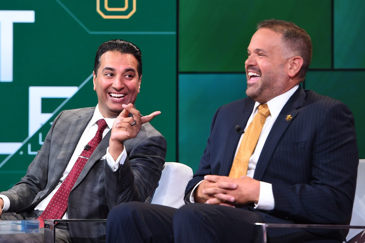 SportsCenter anchor Kevin Neghandi (left), seen here laughing with Baylor football coach Matt Rhule, will anchor ABC's college football coverage this season.