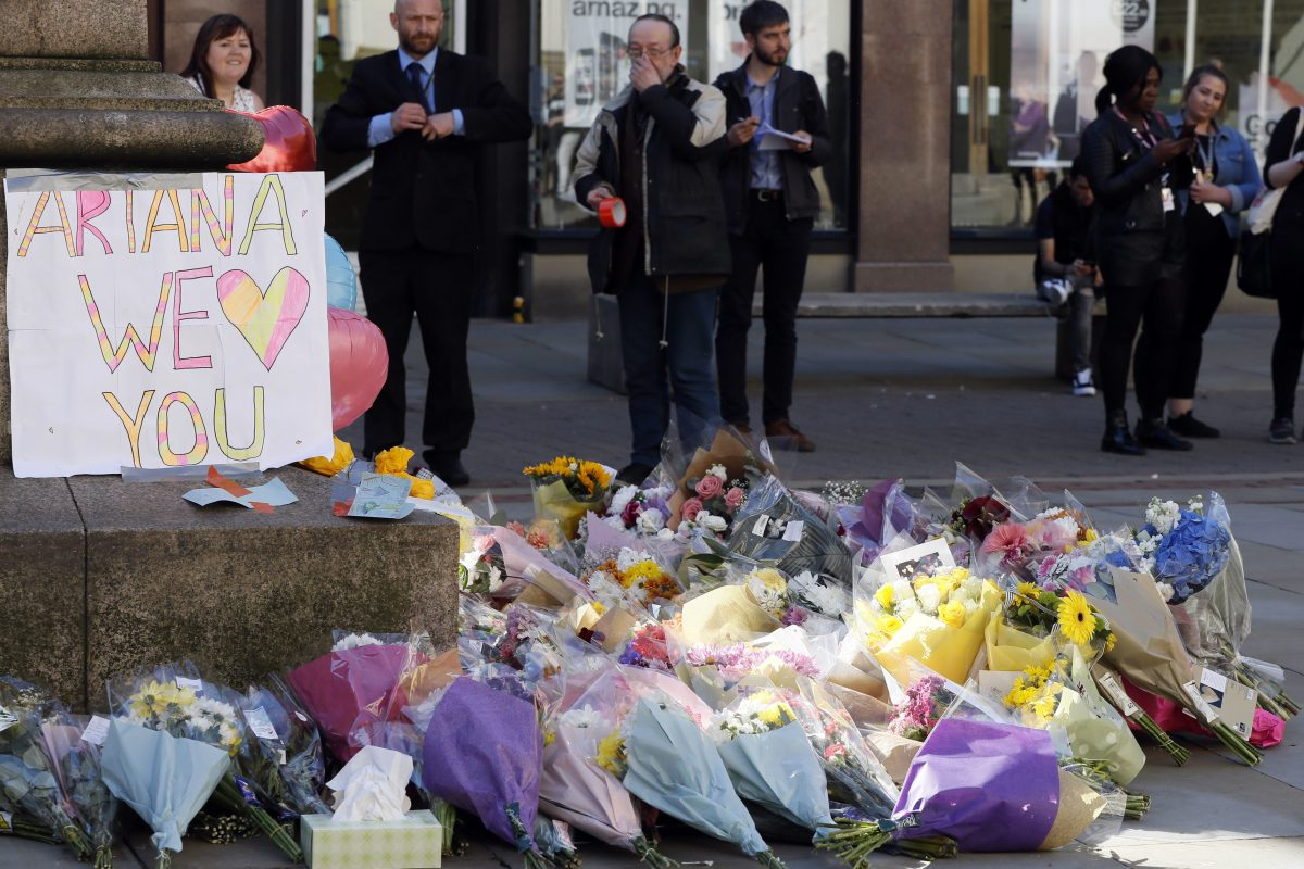 Floral tributes in Manchester, England, the day after the suicide attack at an Ariana Grande concert that left 22 people dead as it ended on Monday night. (AP Photo/Kirsty Wigglesworth)