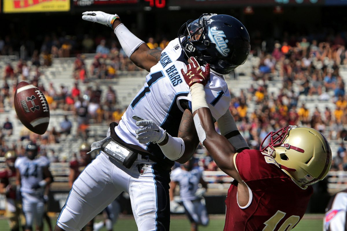 Maine's Najee Goode (1) breaks up a pass intended for Boston College's Thadd Smith in October 2015. Goode graduated from Imhotep Charter. Smith is a Cardinal O'Hara alum.