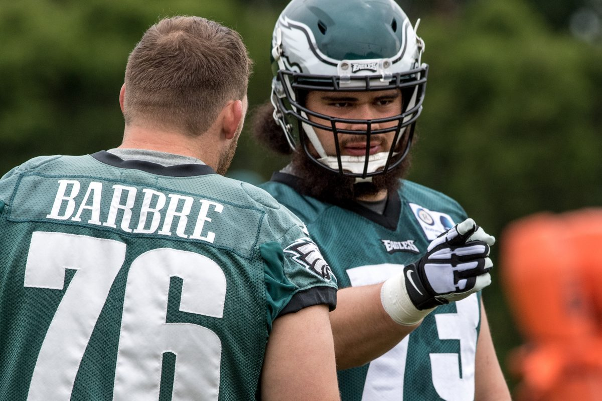 Eagles offensive lineman Isaac Seumalo (right) talks with injured teammate Allen Barbre during the OTAs in May.