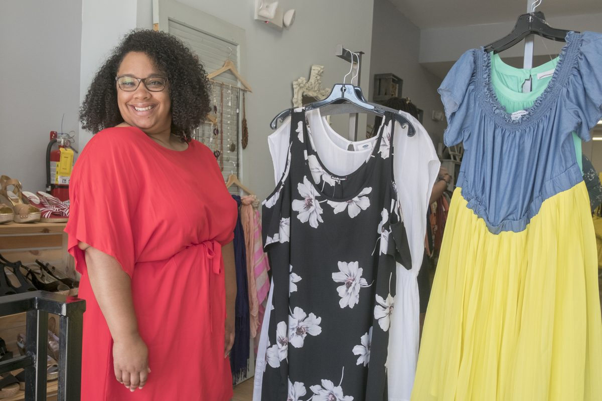 Friday May 19, 2017 Curve Conscious, a plus-size consignment shop on Girard Avenue is one of a few stores of its kind that gives plus-size women the opportunity to buy and sell clothing at a fraction of the price. Here, owner Adrienne Ray with dresses on display in the front of her shop., ED HILLE / Staff Photographer