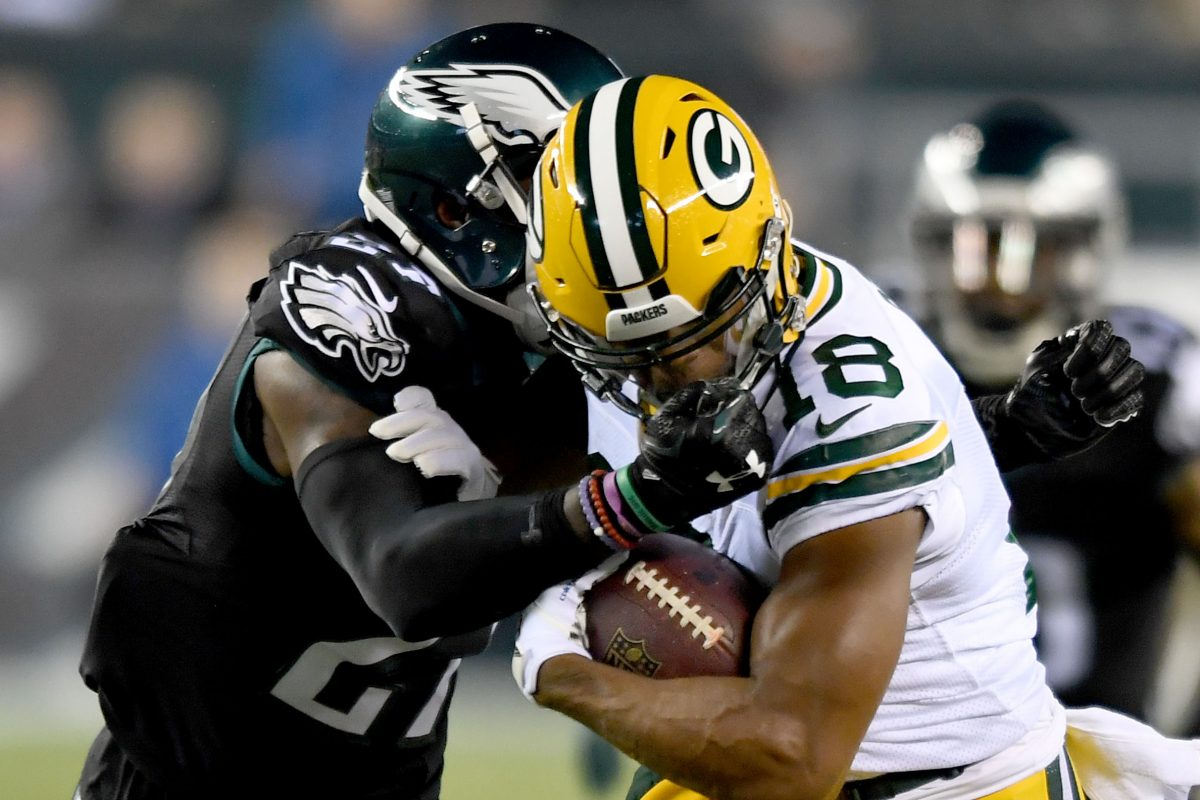 Eagles safety Malcolm Jenkins (left) collides with Packers wide receiver'  Randall Cobb in loss to Green Bay last season.
