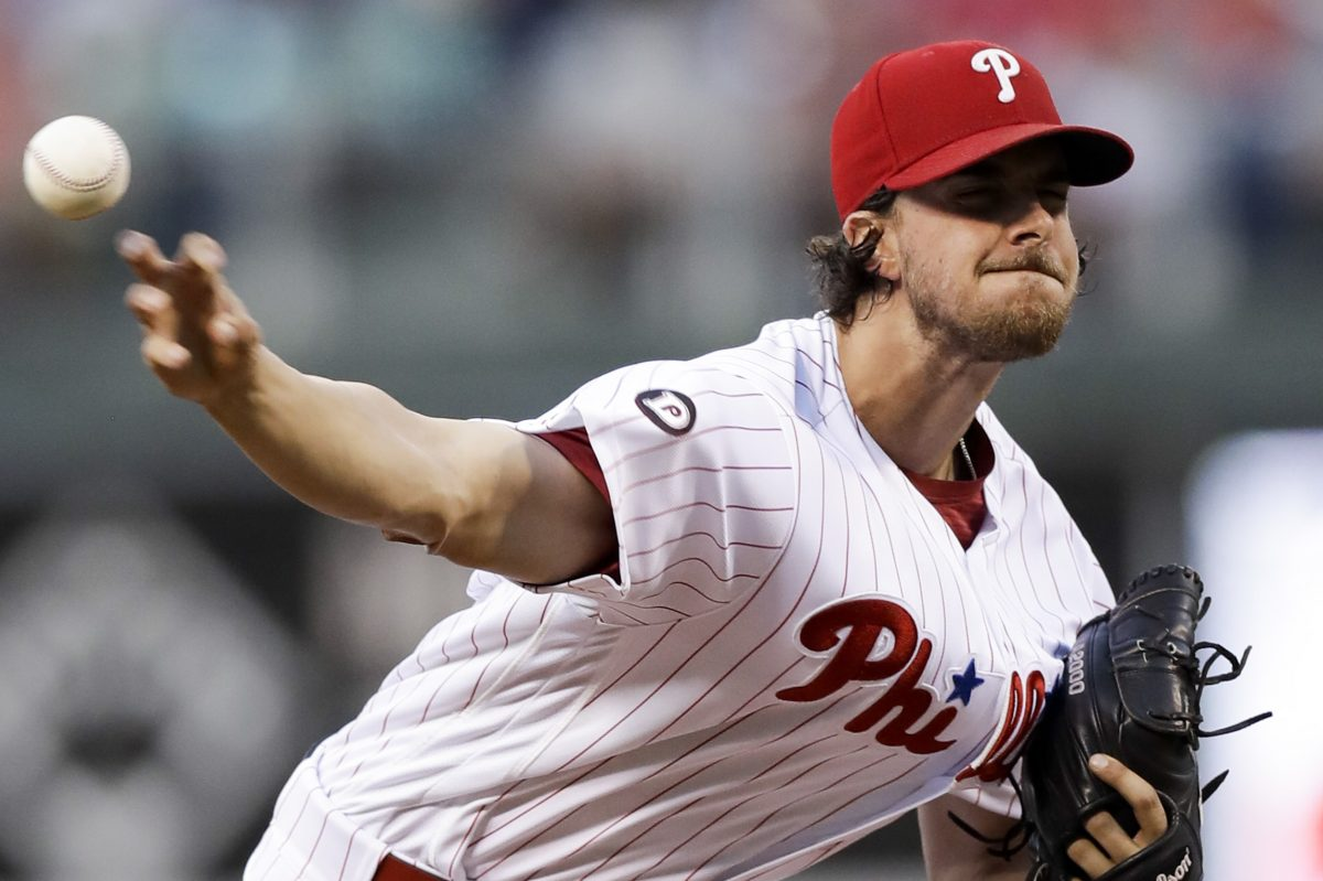 Philadelphia Phillies pitcher Aaron Nola, who finished with 10 strikeouts,  unleashes pitch against Astros during second inning.