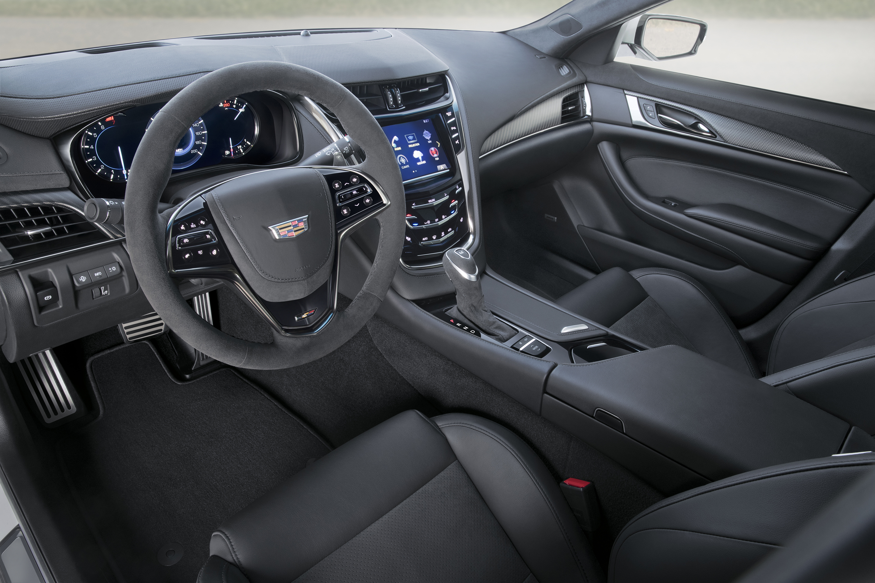 The interior of 2017 Cadillac CTS-V super sedan with the Carbon Black sport package includes low-gloss carbon fiber interior trim, sueded steering wheel and shifter, and standard V-Series performance front seats with available RECARO V-Series front seats. The Carbon Black sport package for 2017 includes the first-ever Black Chrome grille for V-Series models and the first-ever RECARO front seats for Cadillac ATS Sedan and Coupe models among additional exterior and interior appointments.