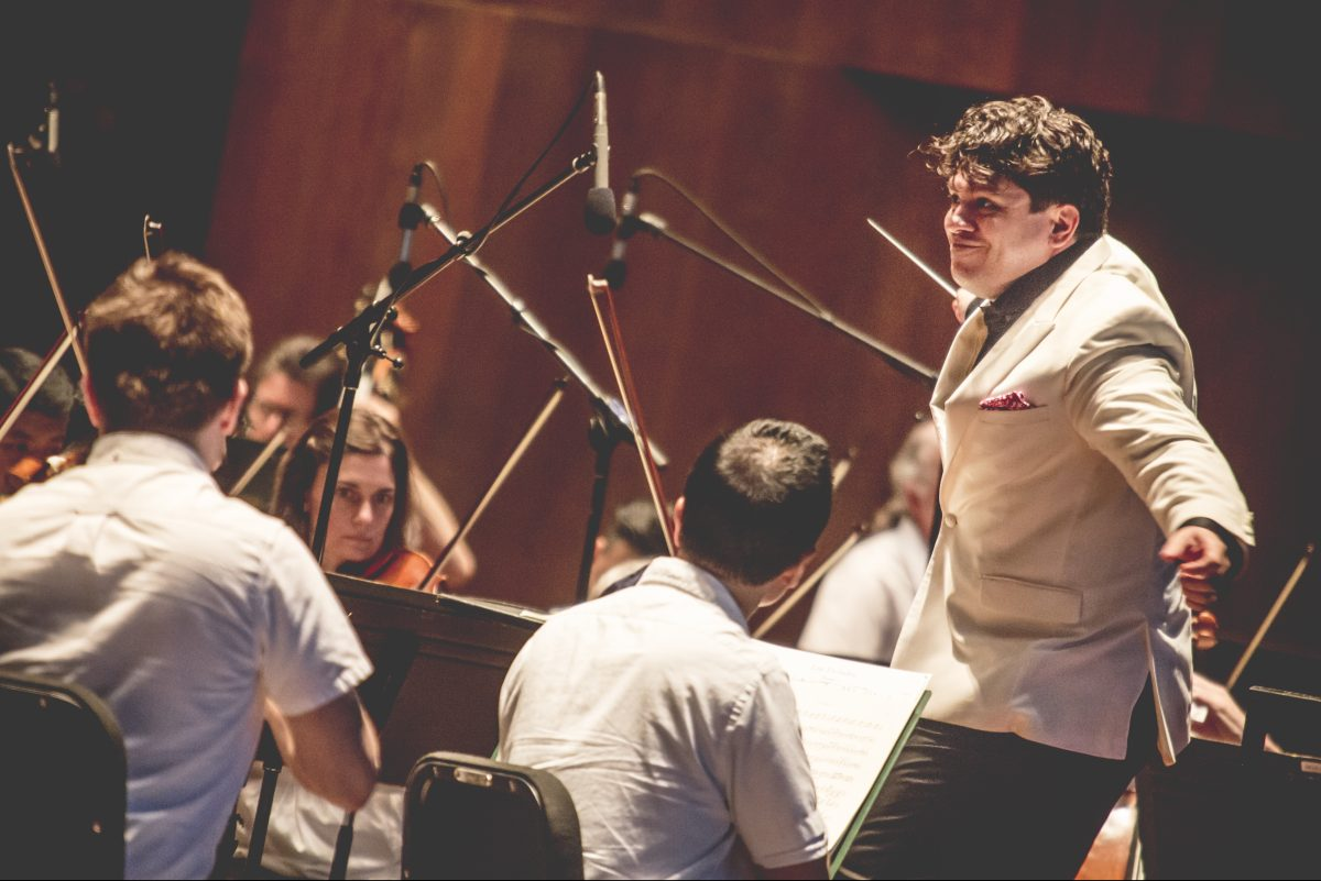 Conductor Cristian Măcelaru (right) with the Philadelphia Orchestra at its Mann Center 'People's Choice' concert Wednesday. (JORDAN AUGUST / Courtesy of Mann Center)
