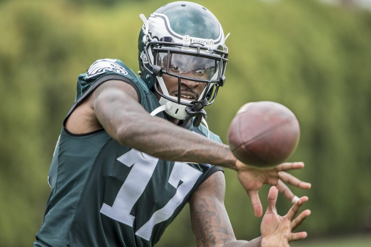 Eagles wide reciever Alshon Jeffery concentrates as the ball comes to him during a passing drill after practice on Thursday. Eagles practice with a full squad on Thursday, the first day of training camp for the entire team.