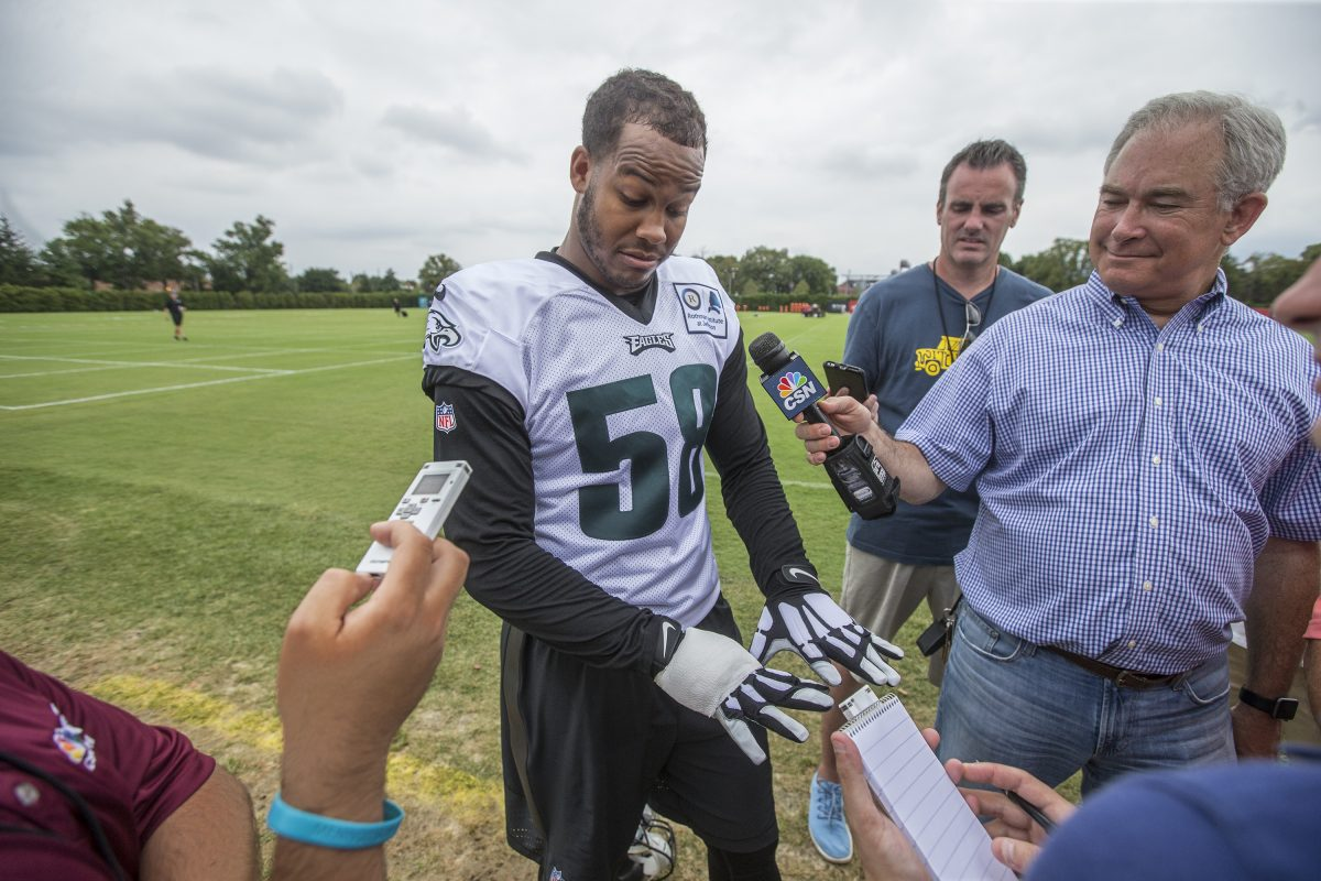 Eagles linebacker Jordan Hicks (center) looks down at his bandaged right hand that he broke on his honeymoon as he explains how it all happened, after the Eagles first full team practice at training camp on Thursday.