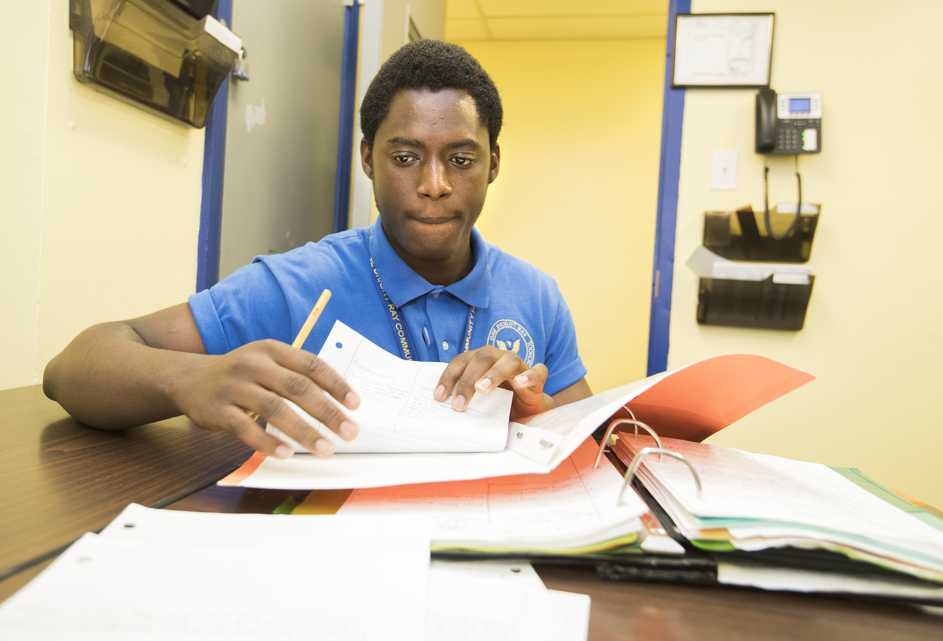 Isaac Appiahene works on a quiz at One Bright Ray Community High School in Fairhill.