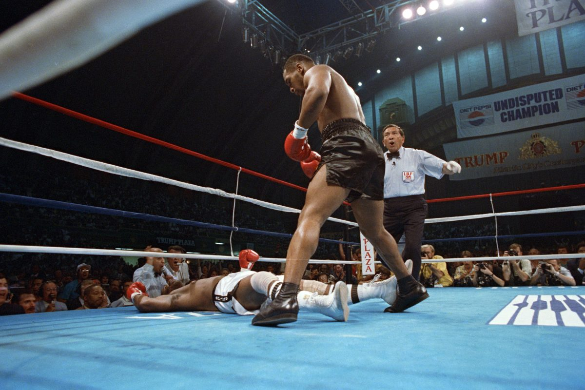 (FILE) Michael Spinks seen on the mattress after he was knocked down by Mike Tyson in their first round for the heavyweight championship which took only 91 seconds in Atlantic City in June 1988.(AP Photo/Richard Drew)