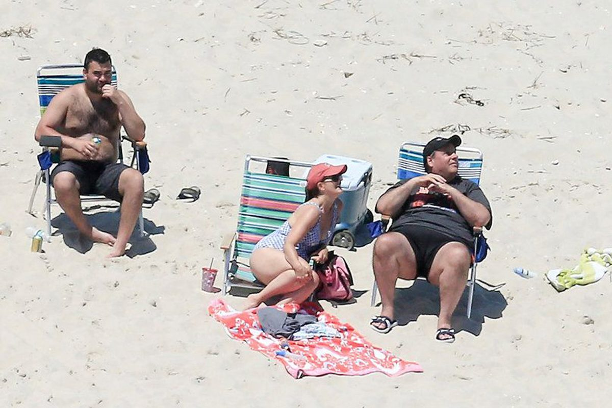 Gov. Chris Christie (right) and his wife Mary Pat enjoy a picture perfect Sunday afternoon at the beach on Island Beach State Park, which is closed to the public due to the state government shutdown.