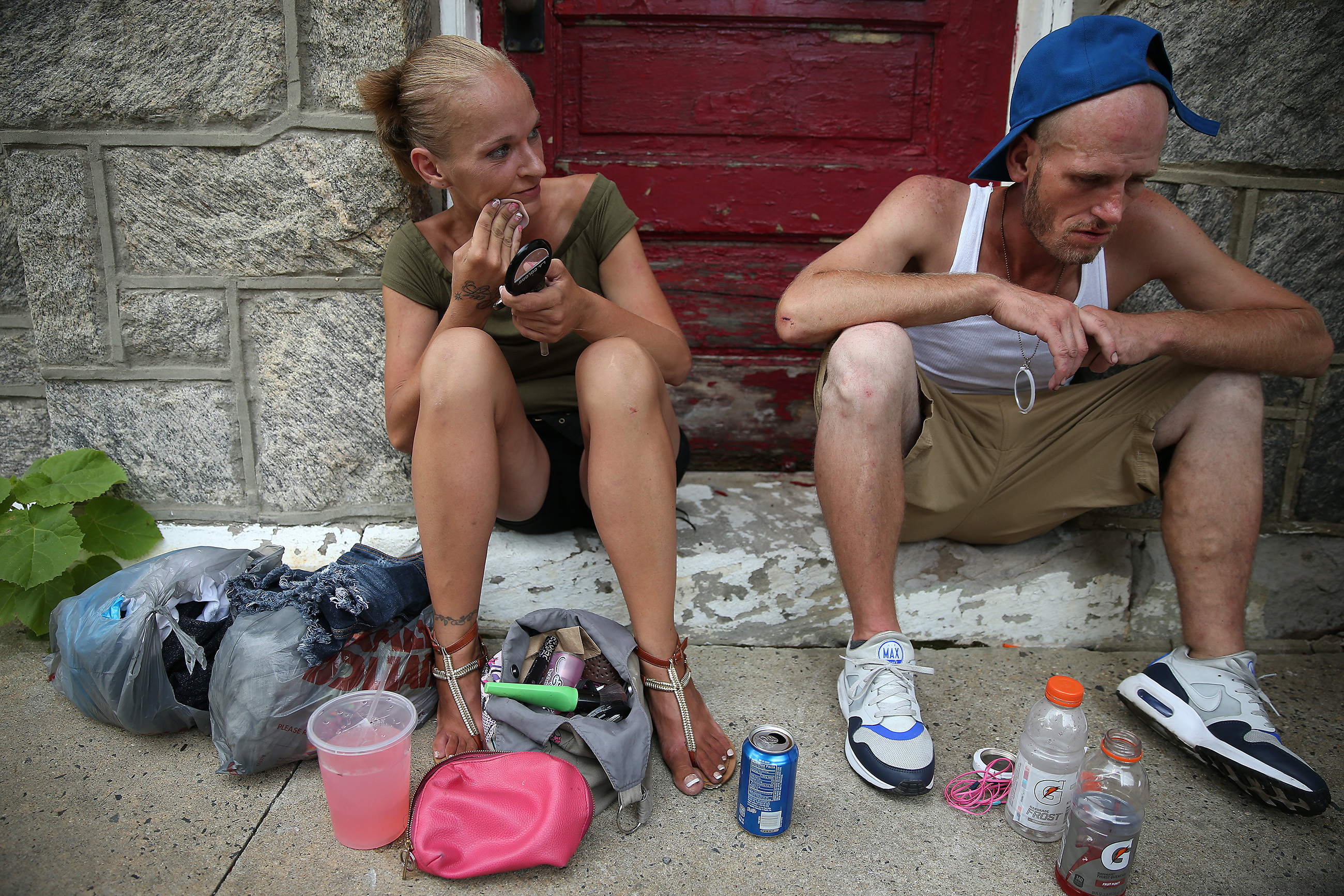 Carol Yancer, left, applies makeup and checks on her boyfriend, Ray Rivero, right, as he begins to nod off in Philadelphia, PA on July 20, 2017.