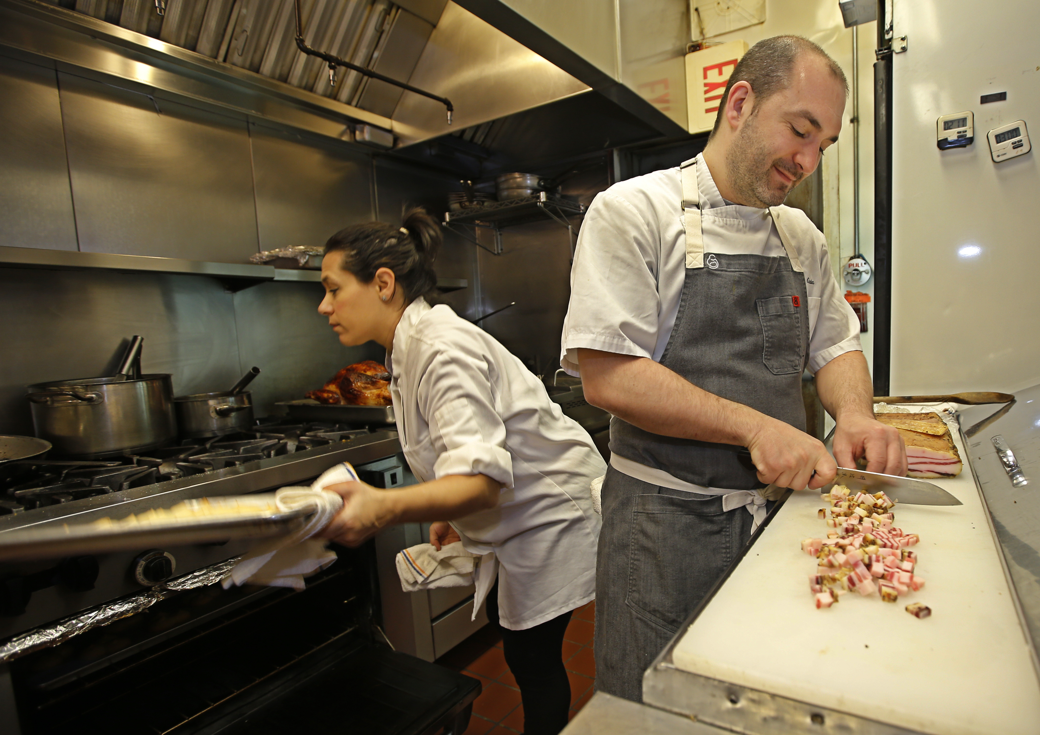 Chef Joe Cicala and his wife, Angela Ranalli-Cicala, working in the kitchen at Le Virtu in 2015.