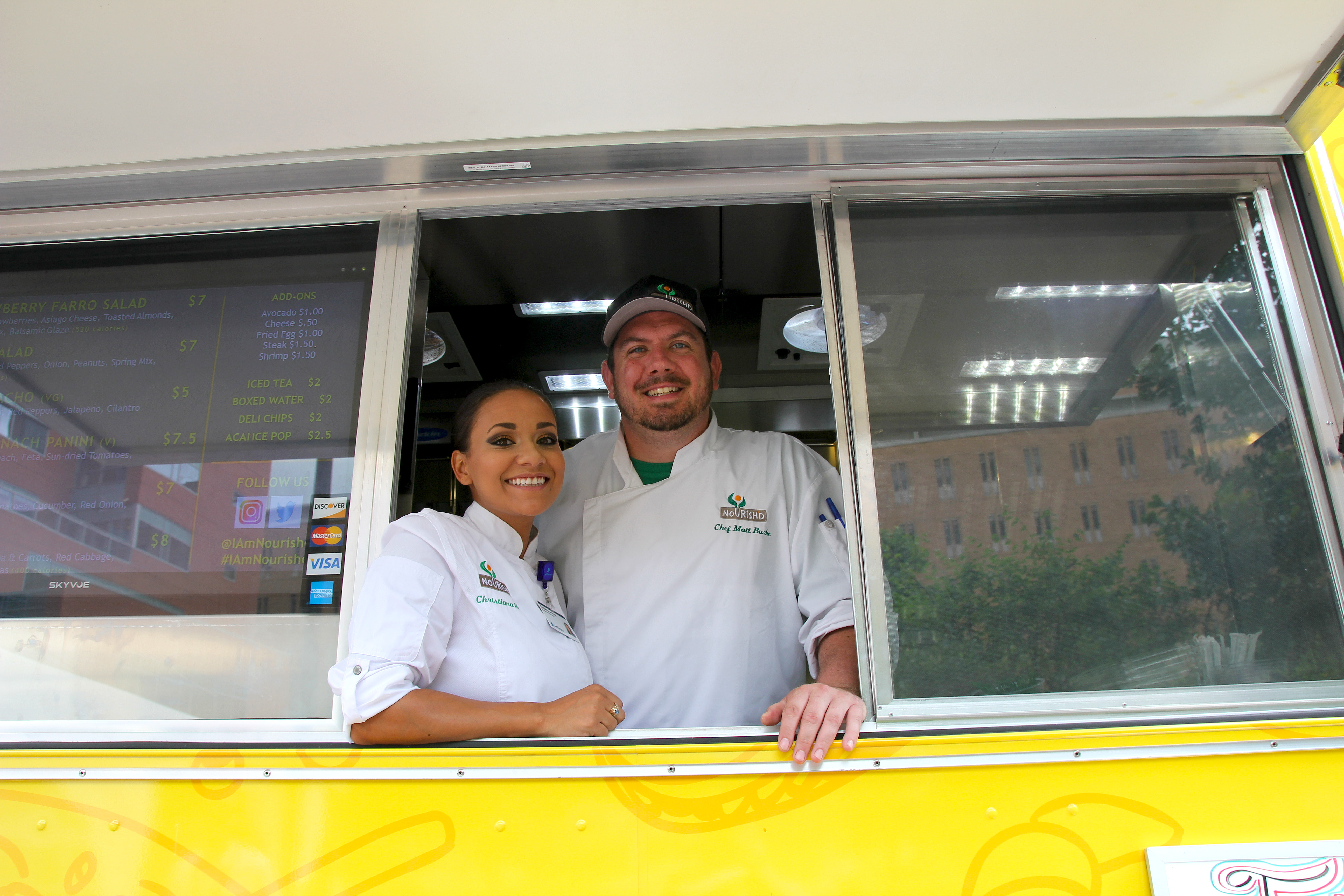 Chef Christiana Ruiz and chef manager Matt Burke at Nourish´d food truck, parked near 10th and Spruce Streets.