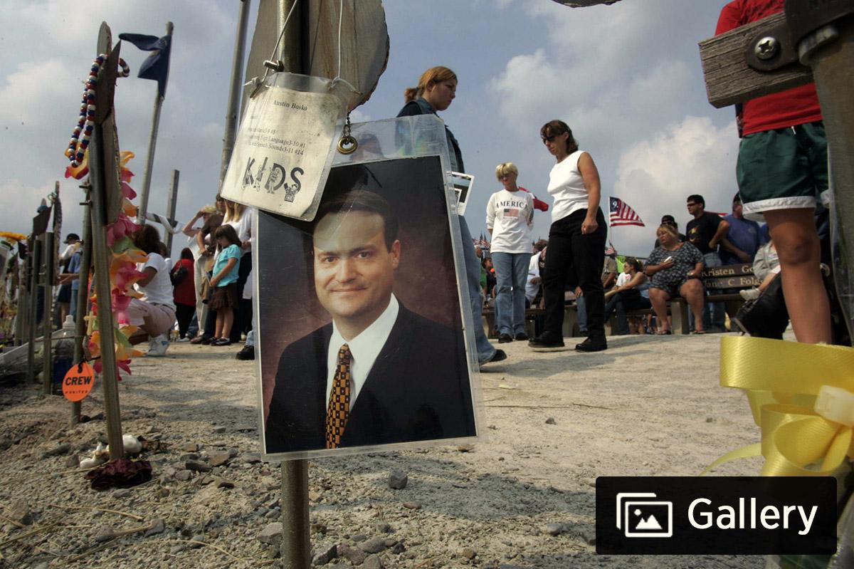 A photo of Thomas E. Burnett Jr, a passenger aboard Flight 93, hangs at the temporary memorial at the Flight 93 crash site in Shanksville, Pa.