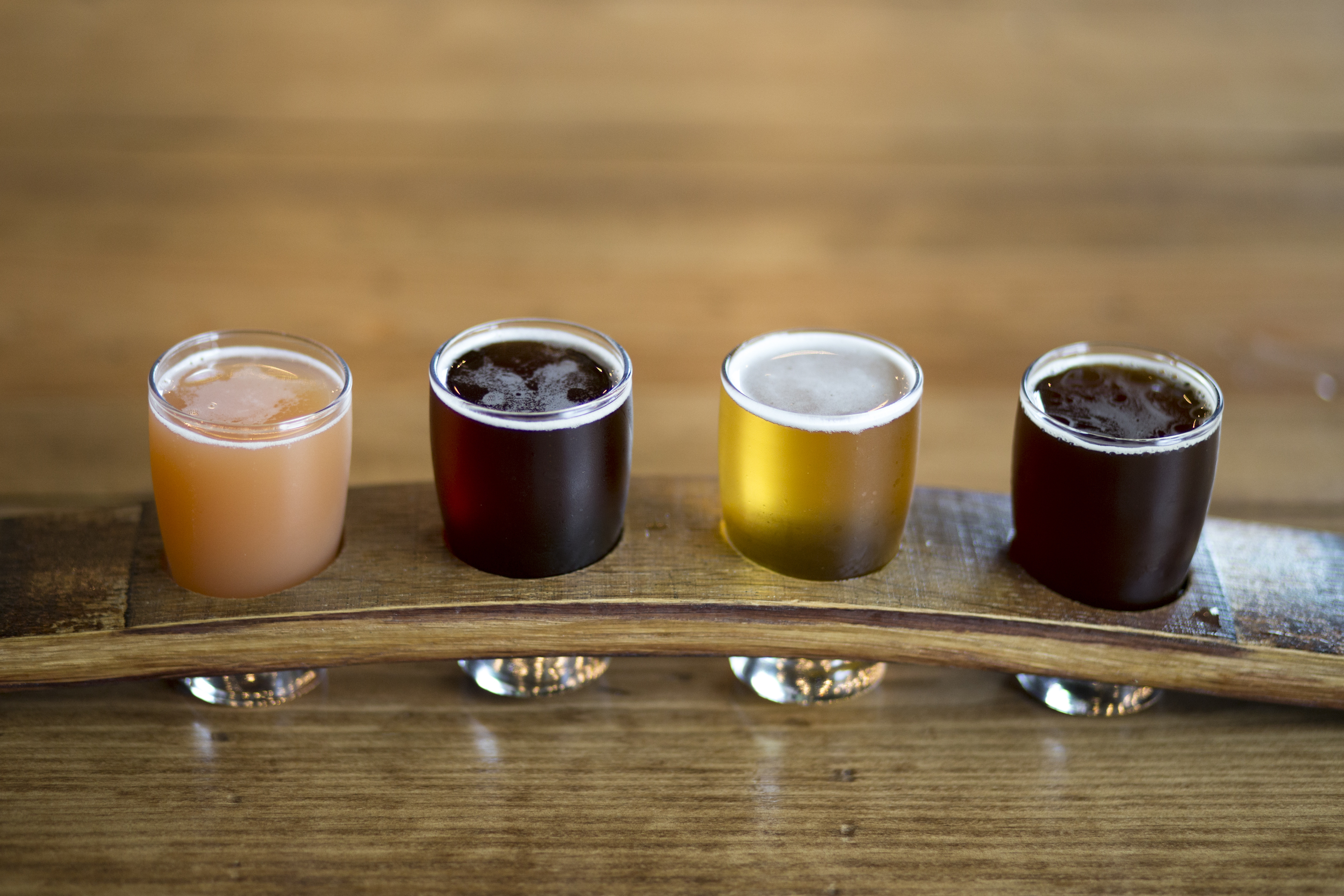 A flight of beers, including (left to right) the strawberry kolsch, Cherry Hound, Captured Culpbrett, and Capt. Bill´s Barleywine at Roy Pitz Barrel House. ( MARGO REED / Staff Photographer )