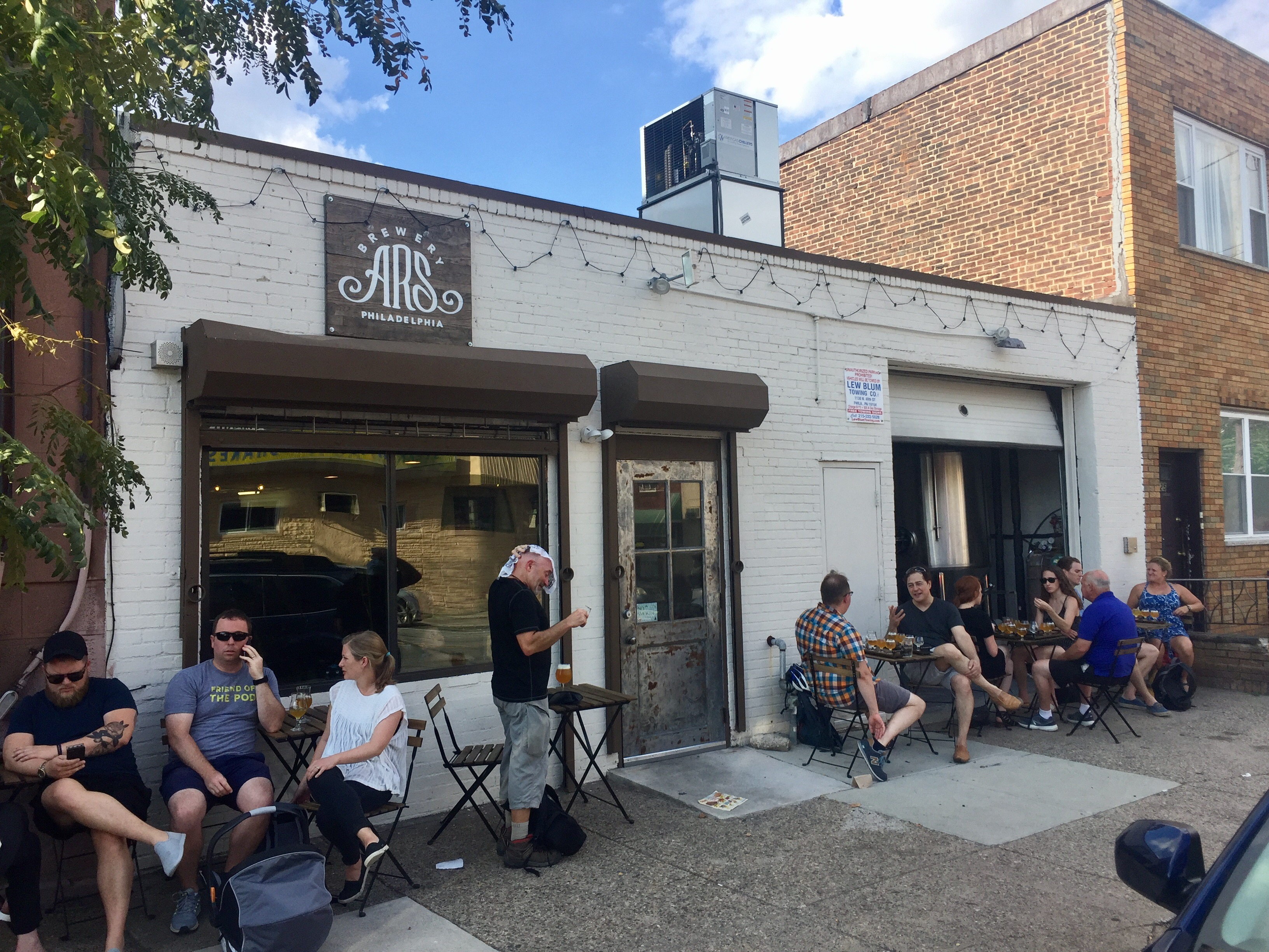 Weekend drinkers sample the beers outside Ars Brewery, which opened this year in a former garage on West Passyunk Ave. CRAIG LABAN/Staff