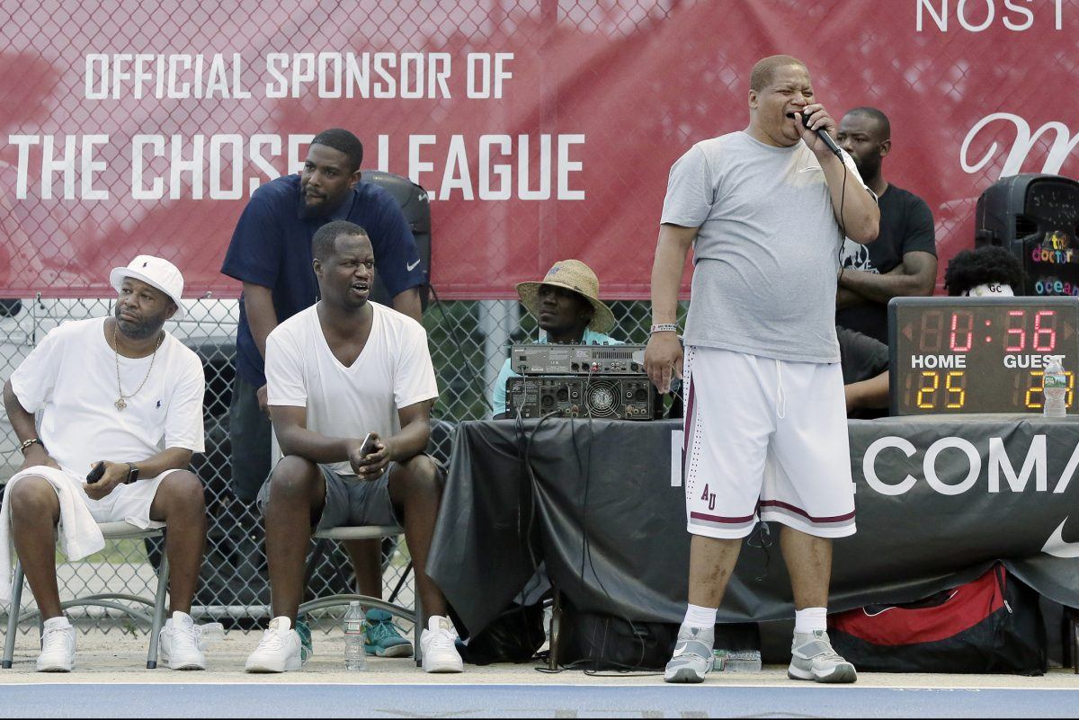 Chosen League founder Rahim Thompson (seated second from left) watches the action while announcer Donald Kenner (standing on right) describes the action at 10th and Olney.