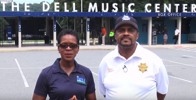 Susan Slawson (left) and Philadelphia Sheriff Jewell Williams discuss new security measures at the Dell Music Center, a concert venue in Fairmount Park.