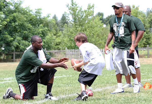 Eagles Wide Receiver DeSean Jackson (near right) coaches Matt Warrington (center), 12, of Moorestown, NJ at the DeSean Jackson Football Camp at Moorestown Upper Elementary School in Moorestown, N.J. on Monday. (Jonathan Yu / Staff Photographer)