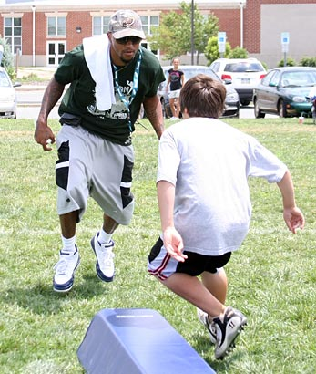 Eagles Wide Receiver DeSean Jackson runs through some drills with Dylan Tocco, 11, of Moorestown, N.J. at the DeSean Jackson Football Camp at Moorestown Upper Elementary School in Moorestown, N.J. on Monday. (Jonathan Yu / Staff Photographer)