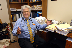 Dr. Arthur Chernoff shown with a mountain of paperwork, required for keeping track of diabetes patients. (April Saul / Staff Photographer)