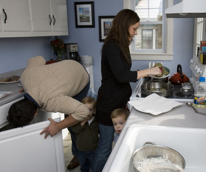 """Maureen and Michael Petrosky prepare an adventurous meal for their twin toddlers - Pirate's Breakfast (fish cakes), laksa lemak and satay. """"Initially kids refuse new foods at this age,"""" Maureen said, """"but if you let them play with the food, eventually they'll put it in their mouths."""""""