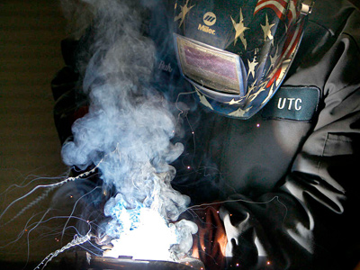 Welder Chris Unruh works on a truck for a Silverliner V at UTCRAS in 2011. (David Maialetti / Staff Photographer)