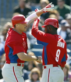 The Phillies&acute; Hunter Pence celebrates his two run first-inning home run<br />with Domonic Brown against the New York Yankees in a spring<br />training game at Steinbrenner Field in Tampa, Florida on Sunday, March<br />4,  2012.  ( Yong Kim / Staff Photographer )