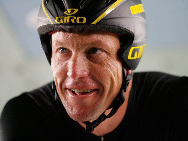 Cyclist Lance Armstrong warms up before riding a Trek prototype bicycle at the Low Speed Wind Tunnel in San Diego, Tuesday, Nov. 4, 2008. Armstrong was at the facility to test the Trek time trials bike. The seven-time Tour de France champion announced in September that he was ending a three-year retirement to draw more attention to his global campaign to fight cancer. He said he would aim for an eighth Tour victory, beginning his campaign in January with a race in Australia. (AP Photo/Denis Poroy)