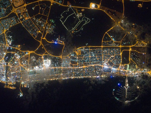 The lights of Dubai, one of the oil-rich United Arab Emirates, seen at night from the space station. The UAE spent the most of any country in 2013 trying to influence policy and public opinion in the USA. (Photo credit: NASA)