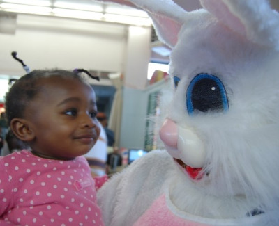 The Easter Bunny holds a girl at last year's event. (Photo credit: Davis' friend Diana Keat)