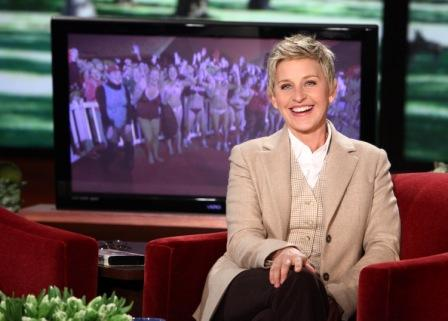Ellen DeGeneres in her Burbank studio with the bathing-suited Villanovans behind her on monitor.