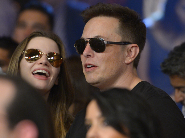 Tesla Motors and Space-X founder Elon Musk, a Penn grad, saw his fortune more than double over a year, according to Forbes´ 2013 ranking of the 400 richest Americans. Photo was taken in Las Vegas at title fight between Floyd Mayweather Jr. and Canelo Alvarez on Sept. 14, 2013. (AP Photo/Mark J. Terrill)