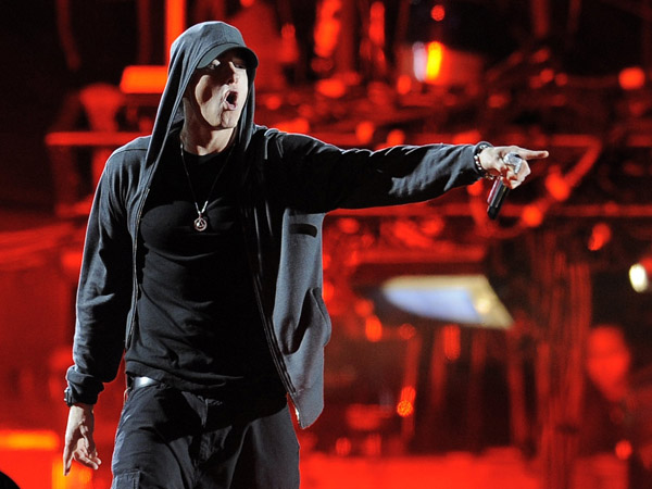 Eminem performs onstage at the 2012 Coachella Valley Music and Arts Festival in Indio, Calif., in April 2012. (AP Photo/Chris Pizzello)