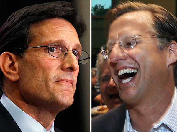 House Majority Leader Eric Cantor, R-Va., left, and Dave Brat, right, react after the polls close Tuesday, June 10, 2014, in Richmond, Va. Brat defeated Cantor in the Republican primary. (AP Photos)