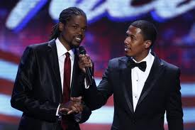 The winner, Landau Eugene Murphy Jr., is congratulated by host Nick Cannon.