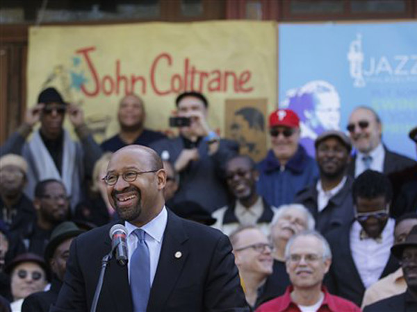 Mayor Michael Nutter speaking outside of the former home of jazz musician John Coltrane. (AP Photo/Matt Rourke)