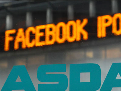 News about the Facebook IPO passes on a billboard outside of NASDAQ in Times Square, New York, Tuesday, May 15, 2012.  Facebook on Tuesday increased the price range at which it plans to sell stock to the public, as investor enthusiasm in the offering continued to mount and boost the potential value of the world´s most popular social network. (AP Photo/Seth Wenig)