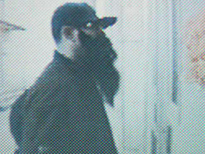 A man sporting a fake bushy beard tried to rob the St. Helena School in Olney Monday morning. (Philadelphia Police Department)