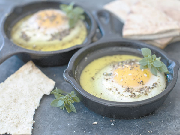 Oven eggs prepared with olive oil and the Egyptian spice blend called<br />dukkah.