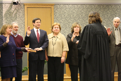 Lower Merion commissioners may test the strength of their oath after Commissioner Jenny Brown called for an investigation of the township´s deferred compensation plan. At their swearing in last January, President of the Board Liz Rogan, Commissioners Daniel Bernheim, Cheryl Gelber and George Manos take an oath.