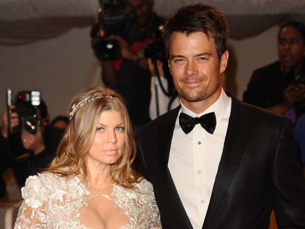 FILE - This is a Monday May 2, 2011 file photo of singer Fergie and her husband, actor Josh Duhamel, arrive at the Metropolitan Museum of Art Costume Institute gala, Monday, May 2, 2011 in New York.  (AP Photos/Peter Kramer, File)