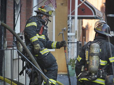 Philadelphia fire department was called to 3462 Joyce St. for a middle of the row house fire on Monday morning November 26, 2012. A resident died and another taken to a local hospital in serious condition. ( Alejandro A. Alvarez / Staff)