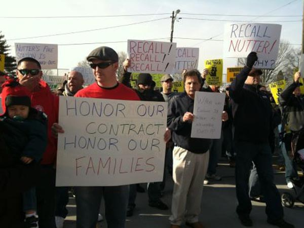 About 200 members of the Philadelphia Firefighters Union disrupted a ribbon cutting ceremony at the new Tacony Fire Station, the first to open in the city in 15 years, in protest of Mayor Nutter. (Miriam Hill / Staff)