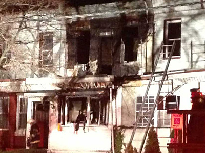 A fire killed one person as it raced through the first and second floors of this rowhouse on the 4900 block of Brown Street in West Powelton in the early morning hours of Jan. 9, 2013. (Emily Babay / Staff)