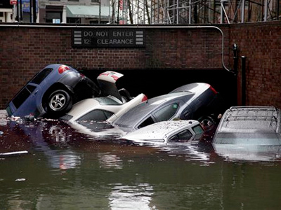 Alarming claims that hundreds of thousands of flood-damaged cars from Superstorm Sandy will inundate the used car market aren't backed up by insurance company claim data, The Associated Press has found. (AP Photo/Richard Drew)