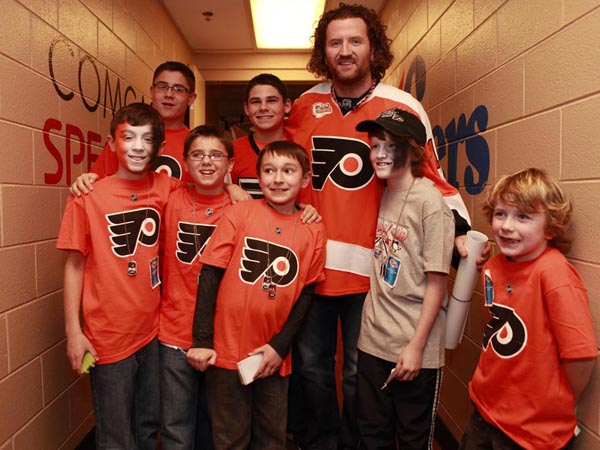 Flyers player Scott Hartnell posed with young fans at the 36th Annual Flyers Wives Fight for Lives Carnival at the Wells Fargo Center on March 3, 2013. ( Hillary Petrozziello / Staff Photographer )